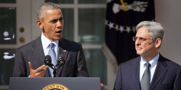 Federal appeals court judge Merrick Garland, right, stands with President Barack Obama as he is introduced...