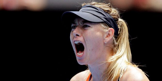 Maria Sharapova of Russia celebrates after winning a point against Serena Williams of the United States...