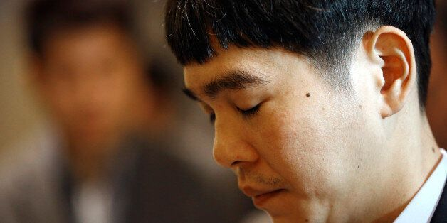 South Korean professional Go player Lee Sedol waits before entering the venue for the third match of...