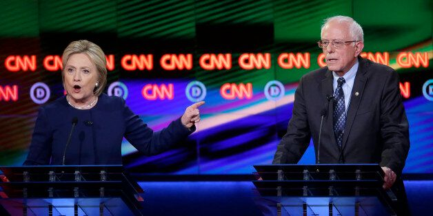 Democratic presidential candidate, Hillary Clinton argues a point as Sen. Bernie Sanders, I-Vt., right,...
