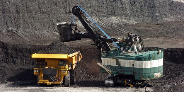 FILE - In this April 4, 2013 file photo, a mechanized shovel loads coal onto a haul truck at the Cloud...