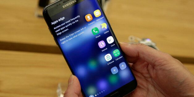 A Samsung Galaxy S7 Edge mobile phone is displayed during a preview of Samsung's flagship store, Samsung...