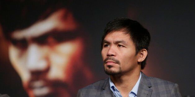 Manny Pacquiao listens during a news conference to promote an upcoming boxing match Thursday, Jan. 21,...