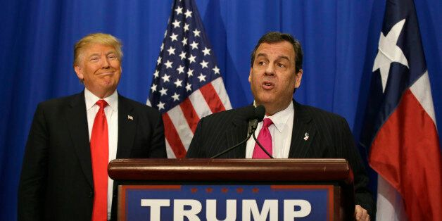 Republican presidential candidate Donald Trump smiles as he stands with New Jersey Gov. Chris Christie...
