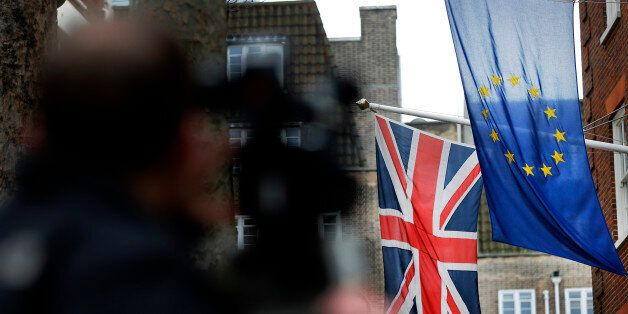 A camera man films the EU flag beside the Union flag at Europa House in London, Wednesday, Feb. 17, 2016....