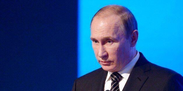 Russian President Vladimir Putin speaks at a meeting of the Russian Chamber of Commerce in Moscow, Russia,...