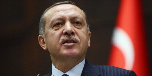 Turkey's Prime Minister Recep Tayyip Erdogan addresses his party members at the parliament in Ankara,...