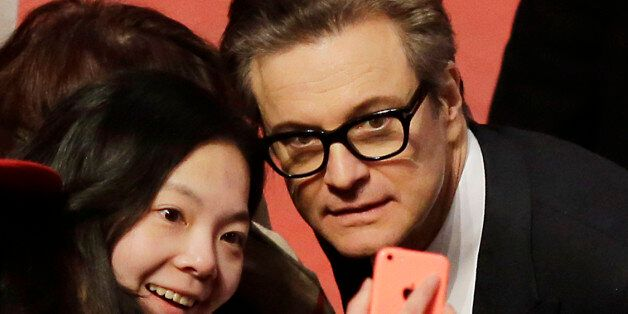 Actor Colin Firth poses for photographs with fans upon arrival at the red carpet of the film 'Genius'...