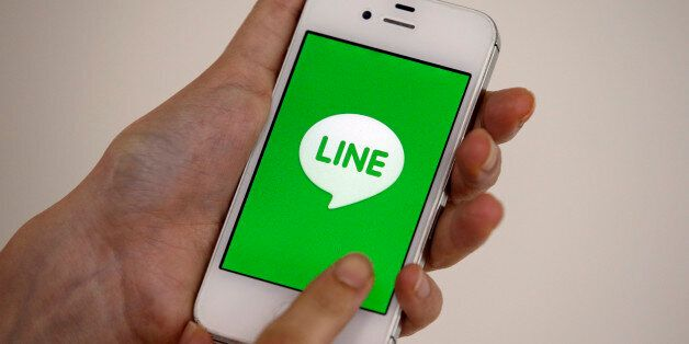 A smart phone is shown with messaging app Line in Seoul, South Korea, Wednesday, July 16, 2014. Naver...