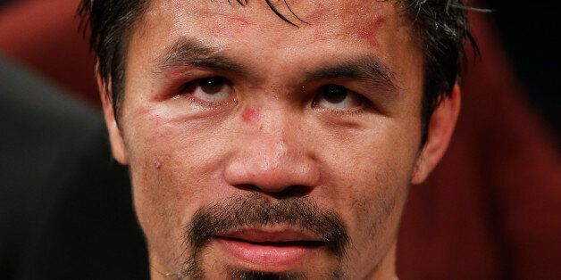 Manny Pacquiao, from the Philippines, waits after the welterweight title fight against Floyd Mayweather...