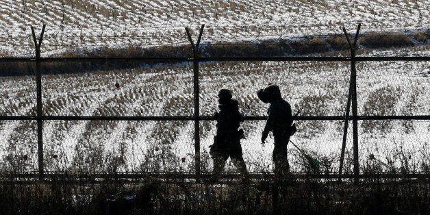 South Korean soldiers patrol near the border village of the Panmunjom (DMZ) that separates the two Koreas...