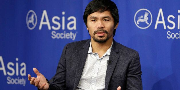 FILE - In this Oct. 12, 2015, file photo, Manny Pacquiao takes questions at the Asia Society in New York....