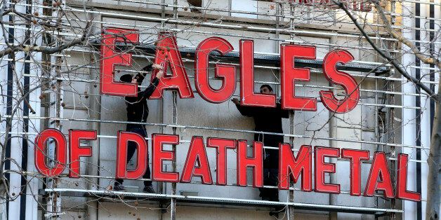 Workers set up ahead a Tuesday's concert by Eagles of Death Metal, at the Olympia music hall, in Paris,...