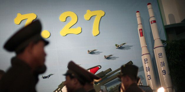 FILE - In this July 26, 2013 file photo, North Korean soldiers tour near model versions of the Unha 3...