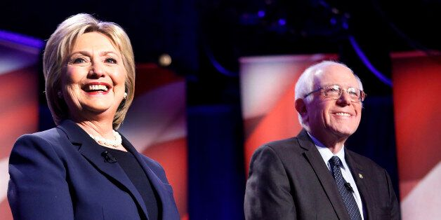 Democratic presidential candidates Hillary Clinton, left, and Sen. Bernie Sanders, I-Vt, pose for a photo...