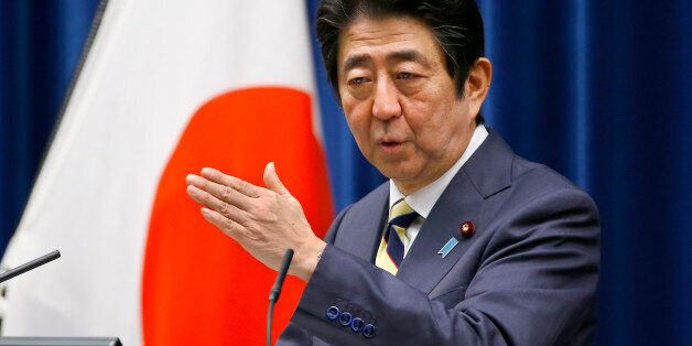 Japanese Prime Minister Shinzo Abe speaks to the media during the New Year's press conference at his...