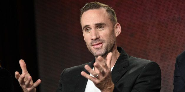 Joseph Fiennes speaks on stage during