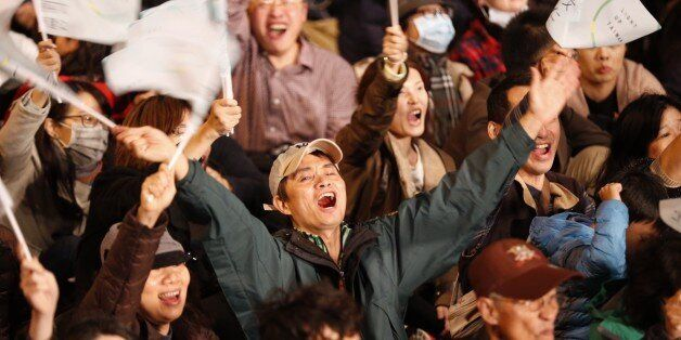 Supporters of Democratic Progressive Party, DPP, presidential candidate Tsai Ing-wen cheer at the campaign...
