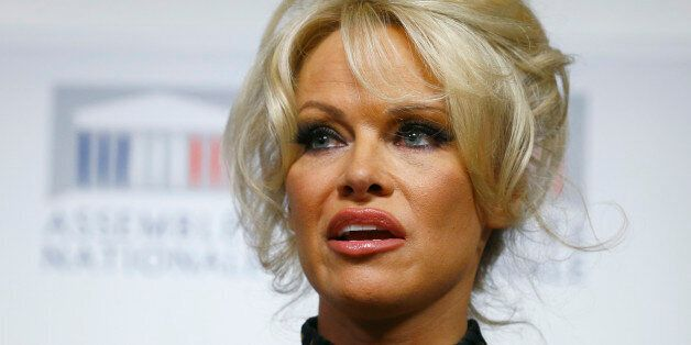 Pamela Anderson, actress and animals rights defender, delivers her speech during a news conference at...