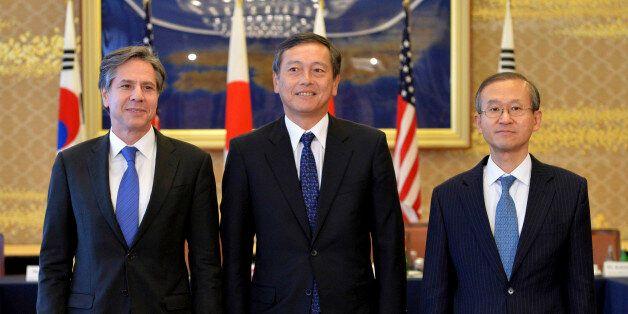 From left, U.S. Deputy Secretary of State Antony Blinken, Japanese Vice Foreign Minister Akitaka Saiki...