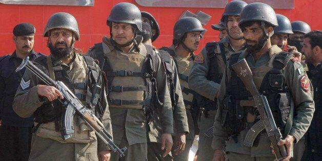 Pakistani troops arrive at Bacha Khan University in Charsadda, some 35 kilometers (21 miles) outside...