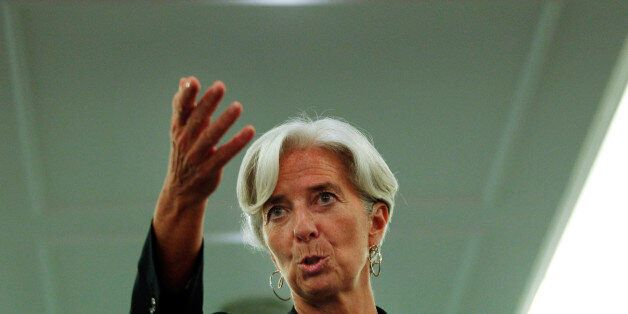 France's Financial Minister Christine Lagarde gestures during a news conference during the African Development...