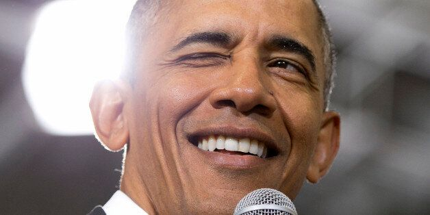 President Barack Obama winks as he speaks during a town hall at McKinley Senior High School in Baton...