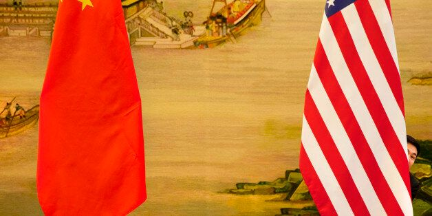 A U.S. flag is tweaked ahead of a news conference between U.S. Secretary of State John Kerry and Chinese...