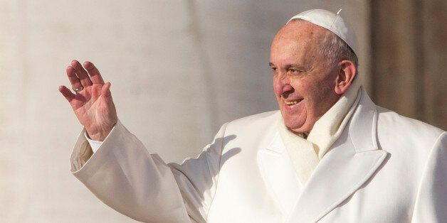 Pope Francis waves as he arrives to hold his weekly general audience, in St. Peter's Square, at the Vatican,...