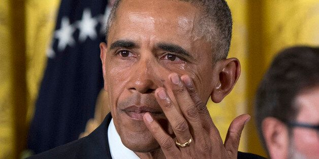 President Barack Obama wipes away tears from his eyes as he speaks in the East Room of the White House...