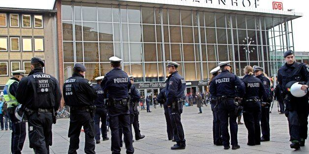 Police officers patrol in front of the main station of Cologne, Germany, on Wednesday, Jan. 6, 2016....