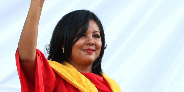 In this Friday, Jan. 1, 2016 photo, Gisela Mota waves during her swearing in ceremony as mayor of Temixco,...