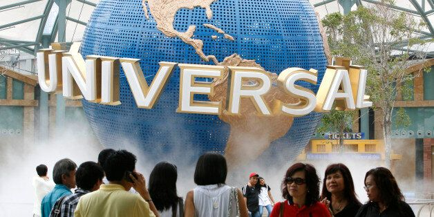 Crowds of people are seen in front of the Universal Studio globe during a media preview at the Universal...