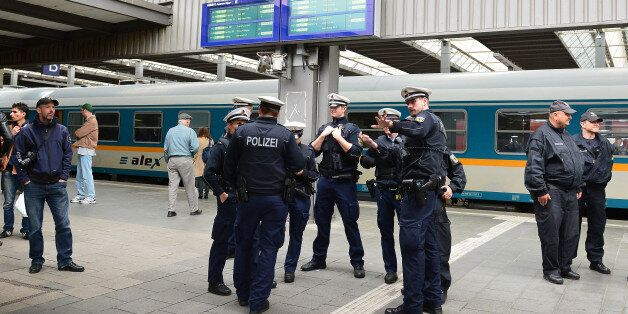 Police wait for the arrival of refugees at the main train station in Munich, Germany, Monday, Sept. 7,...