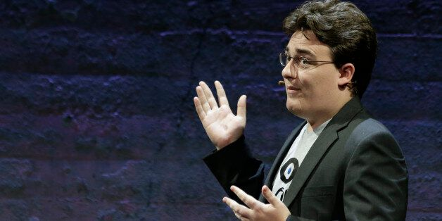 Oculus Founder Palmer Luckey talks about the Rift virtual-reality headset during a news conference Thursday,...