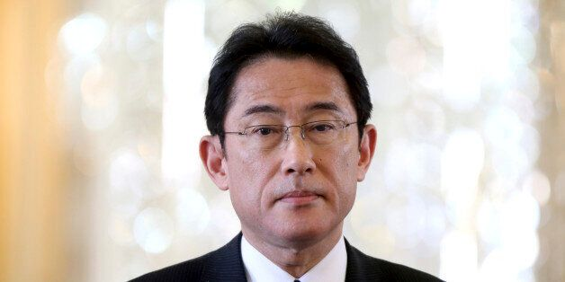 Japanese Foreign Minister Fumio Kishida speaks during a press conference with his Iranian counterpart...