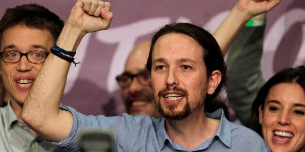 Podemos party leader Pablo Iglesias, center, celebrates next to other party leaders following the latest...