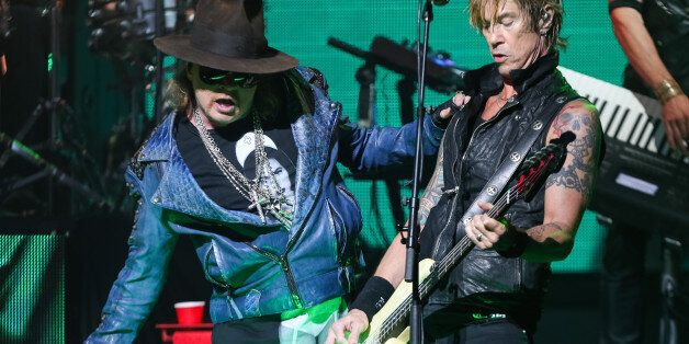 Axl Rose, left, and Duff McKagan of Guns N' Roses perform at the 6th Annual Revolver Golden Gods Award...