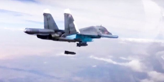 In this photo made from video footage provided by the Russian Defense Ministry on Wednesday, Dec. 9,...