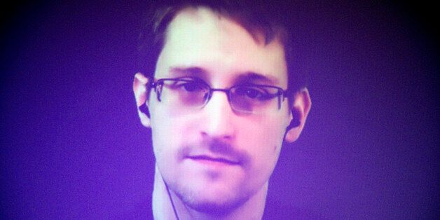 Former U.S. National Security Agency contractor Edward Snowden, who is in Moscow, is seen on a giant...