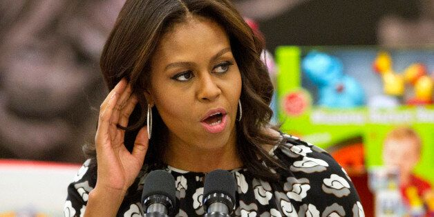 First lady Michelle Obama listens for a shout out from members of the military as she speaks before sorting...