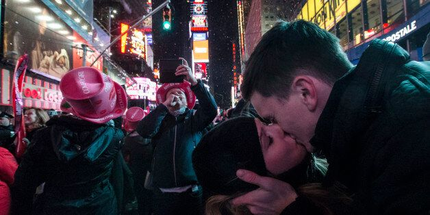 Sean Reilly and Emily Verselin share a kiss at midnight in Times Square during a New Year's Eve celebration,...