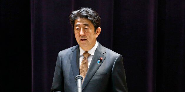 Japanese Prime Minister Shinzo Abe addresses the senior officers of Japan's self defense forces at the...