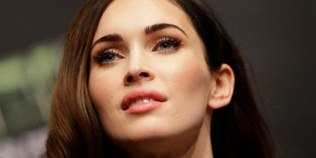 Megan Fox listens to reporters' question during a press conference for her latest
