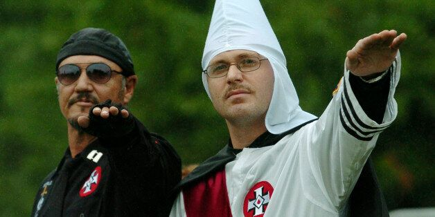 Members of the World Order of the Ku Klux Klan give a salute during a protest rally at the Gettysburg...