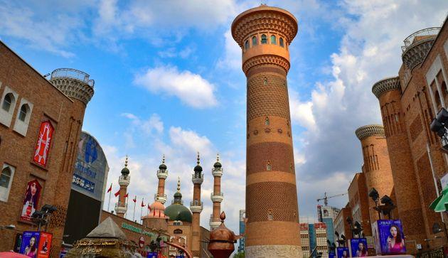 Silk Road: Urumqi Grand Bazaar tower and old Tartar mosque in Muslim district - Xinjiang Autonomous Region,