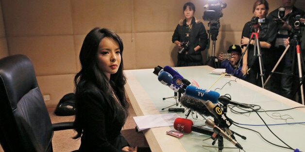 Canada's Miss World contestant Anastasia Lin speaks to media after she was denied entry to mainland China,...