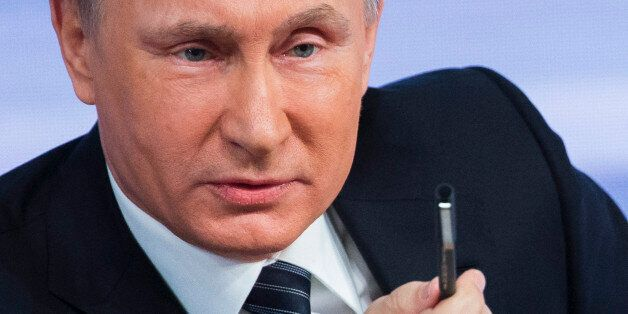 Russian President Vladimir Putin speaks during his annual end of year news conference in Moscow, Russia,...