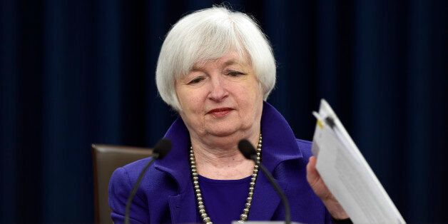 Federal Reserve Chair Janet Yellen closes her notebook after holding a news conference in Washington,...
