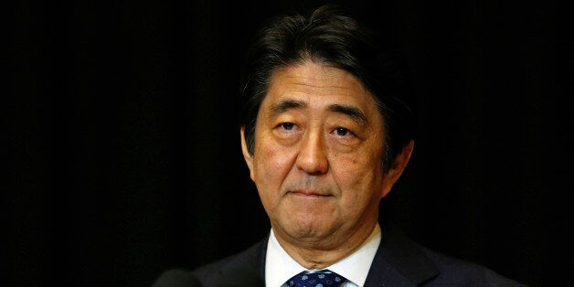 Japanese Prime Minister Shinzo Abe pauses during a press conference in Kuala Lumpur, Malaysia, Sunday,...